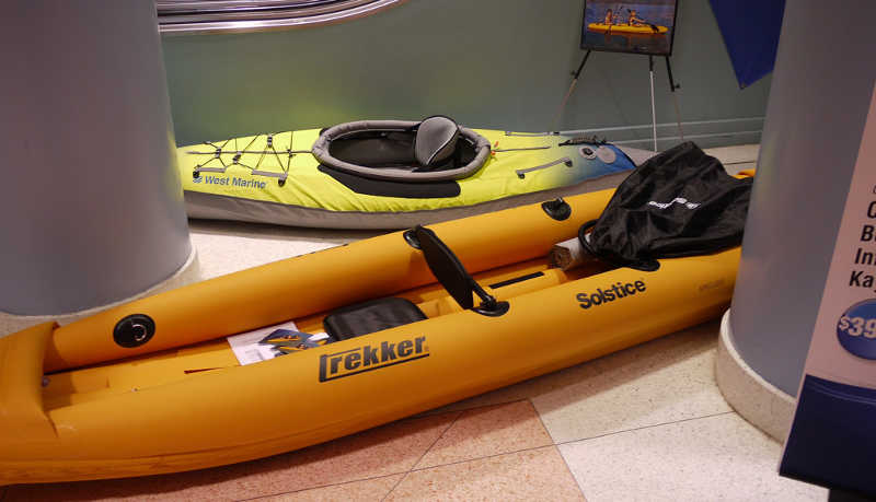 inflatable kayaks lying around in a store